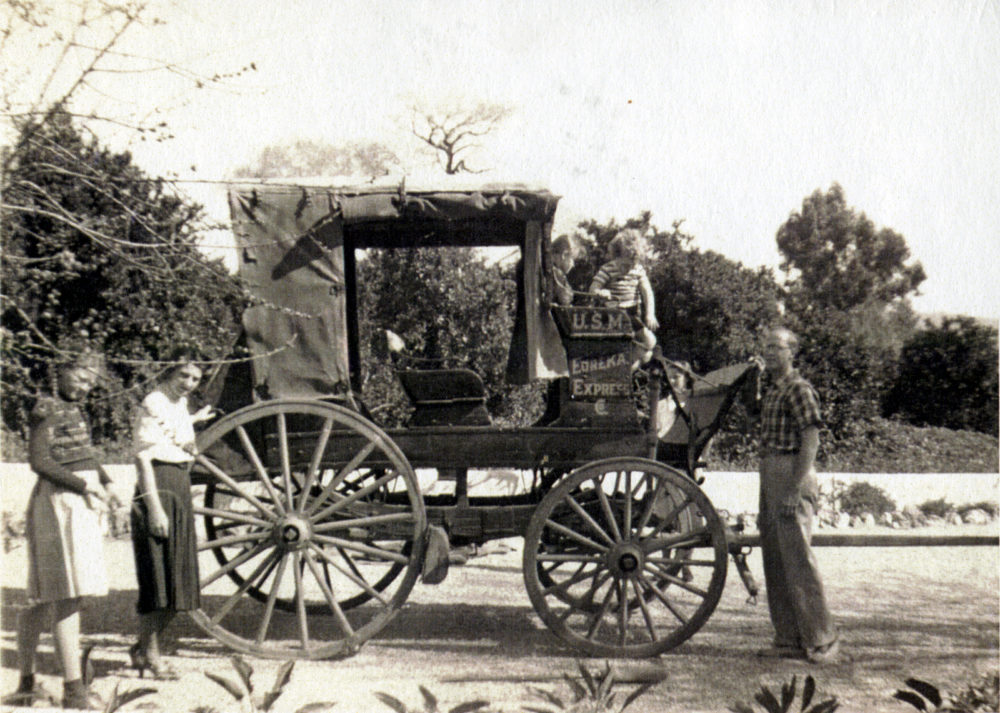 "Rübel family with buggy from del Valle era at Rancho Camulos. From left: Unknown; Mary Rübel (mom); Nathalie (""Boo"") and Shirley (""Pete"") in driver's seat; August Rübel (dad). April 23, 1938"